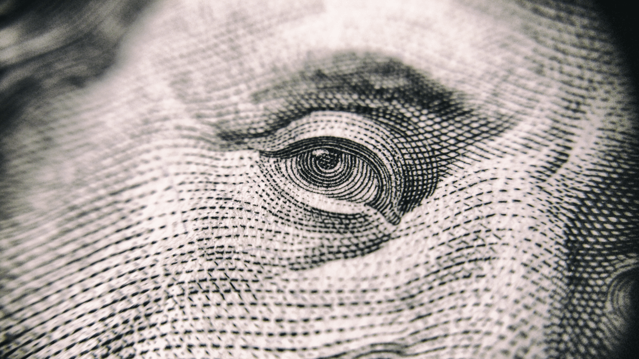 Close up of the eye on 100 dollar bill